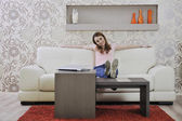Woman relaxing and working at home — Stock Photo