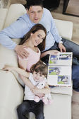 Happy family looking photos at home — Stok fotoğraf