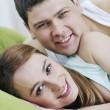 Foto Stock: Young couple in bed
