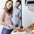 Couple preparing healthy food in kitchen — Stock Photo #2856713