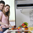 Couple preparing healthy food in kitchen — Stock Photo