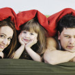 Royalty-Free Stock Photo: Happy family relaxing in bed