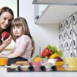 Happy daughter and mom in kitchen — Foto de Stock