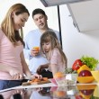 Happy young family in kitchen — Stockfoto #2856828