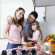Happy young family in kitchen — Stock Photo #2856838