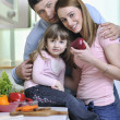 图库照片: Happy young family in kitchen