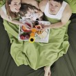 Happy young family eat breakfast in bed — Stock Photo #2856872
