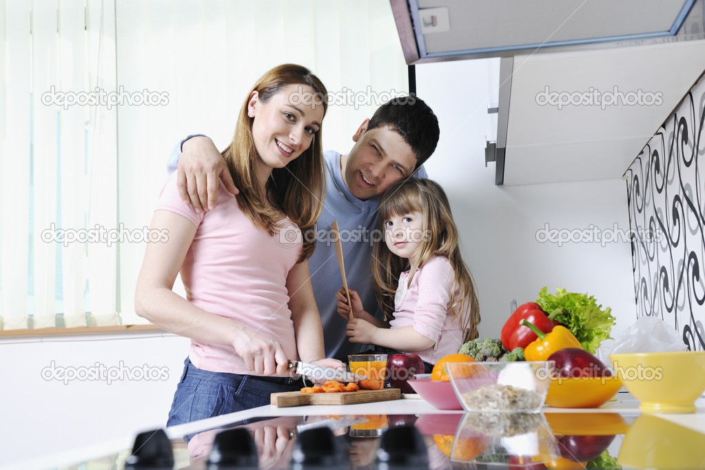 happy young family in kitchen  stock photo © .shock,