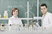 Students couple in lab — Stock Photo