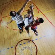 Stock Photo: Playing basketball game