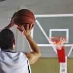 Basketball player shooting — Stock Photo #3078390