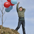 Girl with balloons outdoor — Stock Photo #3104381