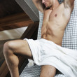 Attractive young man in sauna — Stock Photo