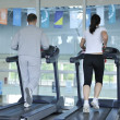Running on threadmill at fitness club — Stock Photo