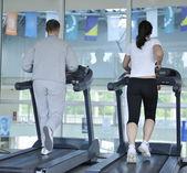 Running on threadmill at fitness club — Stock Photo
