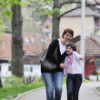 Happy girl and mom outdoor - 