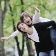Happy girl and mom outdoor — Stock Photo #3193956