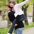 Stock Photo: Happy girl and mom outdoor