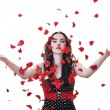 Woman with falling rose petals - Stock Photo