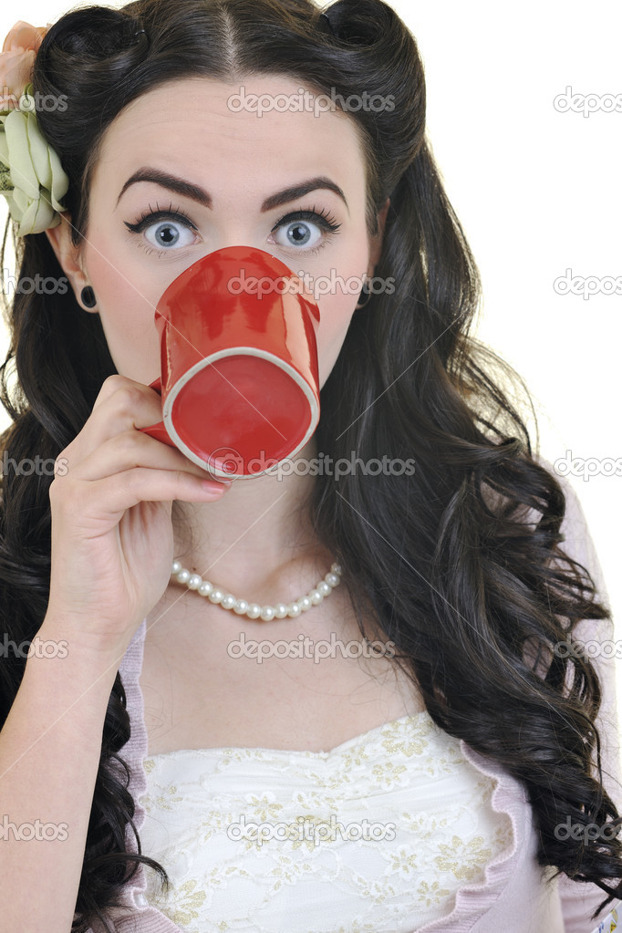 Beautiful happy young woman with red coup of coffee isolated on white — Stock Photo #3286484