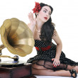 Pretty girl listening music on old gramophone — Stock Photo #3291275