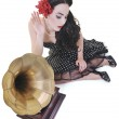 Pretty girl listening music on old gramophone — Stock Photo #3291283