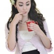 Beautiful young woman with red coup of coffee isolated on white — Stock Photo