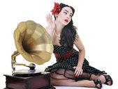 Pretty girl listening music on old gramophone — Stock Photo