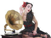 Pretty girl listening music on old gramophone — Stock Photo
