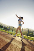 Woman jogging at early morning — Stock Photo