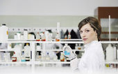 Young woman in lab — Stock Photo