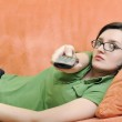 Young woman relax on orange sofa — Stock Photo #3374114