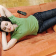 Young woman relax on orange sofa — Stock Photo