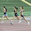 Royalty-Free Stock Photo: Girls running on athletics race track
