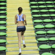 Woman jogging at athletics stadium — Stock Photo