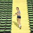 Royalty-Free Stock Photo: Woman jogging at athletics stadium