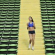Stock Photo: Woman jogging at athletics stadium