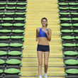 Woman jogging at athletics stadium — Stock Photo #3375823