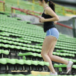 Woman jogging at athletics stadium — ストック写真