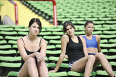 Group of athletics girls relax at soccer stadium — Stock Photo