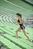 Woman jogging at athletics stadium — Stock Photo