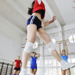 Royalty-Free Stock Photo: Girls playing volleyball indoor game