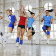 Girls playing volleyball indoor game — Stock Photo