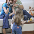 Happy family special moments on video - Stock Photo