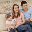 Stock Photo: Happy young family at home