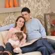 Happy young family at home — Stock Photo