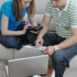 Young couple working on laptop at home — Foto Stock
