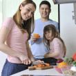 Happy young family in kitchen — Stock fotografie
