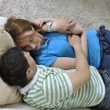 Couple relax at home on sofa in living room — Stockfoto