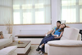 Couple relax at home on sofa in living room — Stock Photo